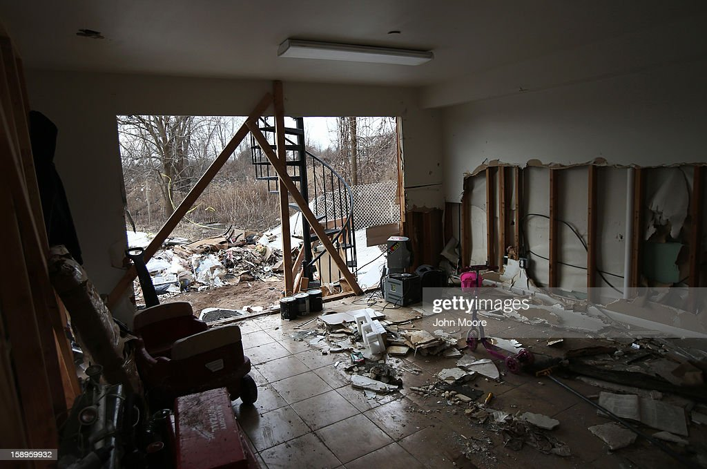 A storm-damaged home awaits repair on January 4, 2013 in the Midland Beach area of the Staten Island borough of New York City. More than two months after Superstorm Sandy, Congress passed legislation today that will provide $9.7 billion to cover insurance claims filed by people whose homes were damaged or destroyed by Sandy.