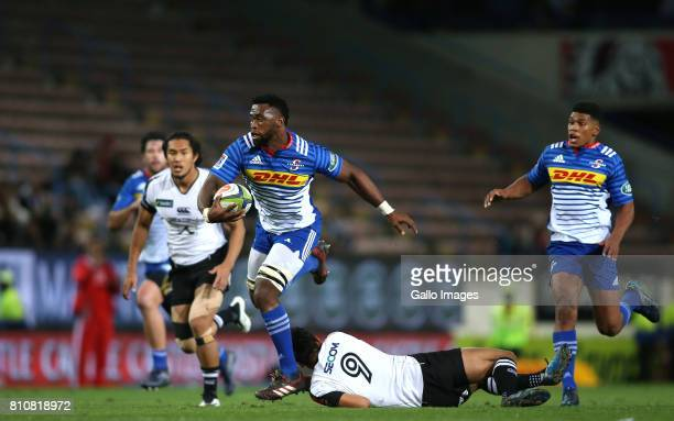 Stormers captain Siya Kolisi slips Keisuke Uchida of Sunwolves attempted tackle during the Super Rugby match between DHL Stormers and Sunwolves at...