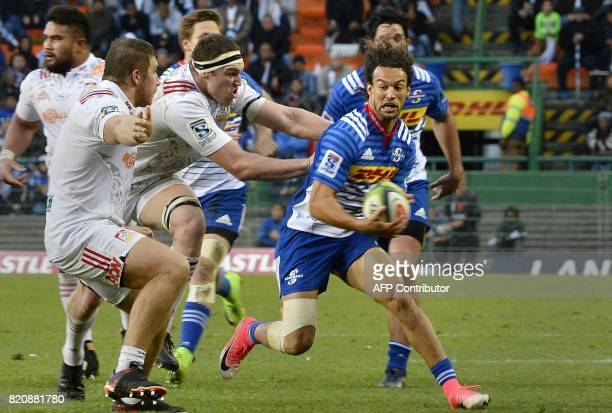 Stormers' Dillyn Leyds tries to avoid a tackle during the Super Rugby quarterfinal match between the Chiefs and the Stormers at Newlands Stadium in...