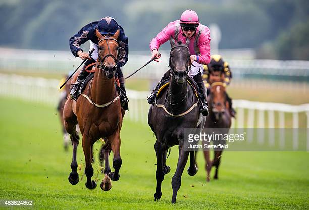 Stormflower riddden by William Carson wins the Orpheus Centre Median Auction Maiden Stakes at Lingfield Park on August 13 2015 in Lingfield England
