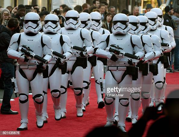 Stormtrooper characters march down the red carpet at the premiere of Walt Disney Pictures and Lucasfilm's 'Star Wars The Force Awakens' at the Dolby...