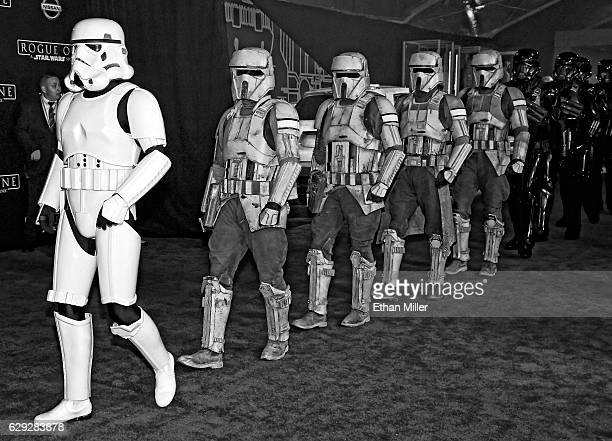 Stormtrooper characters march down the red carpet at the premiere of Walt Disney Pictures and Lucasfilm's 'Rogue One A Star Wars Story' at the...
