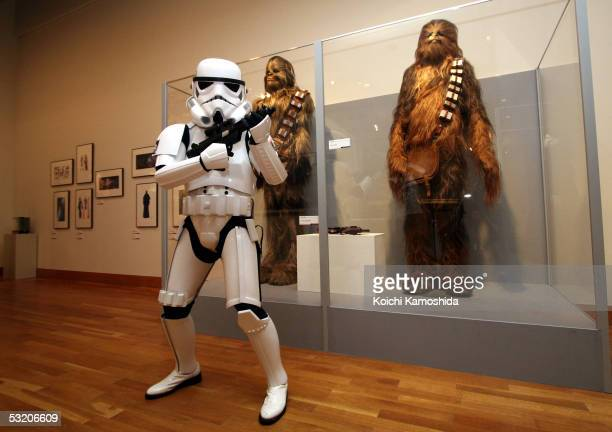 A stormtrooper poses during the opening ceremony of the new Star Wars Episode 3 exhibit at the Meguro Art Museum on July 7 2005 in Tokyo Japan The...