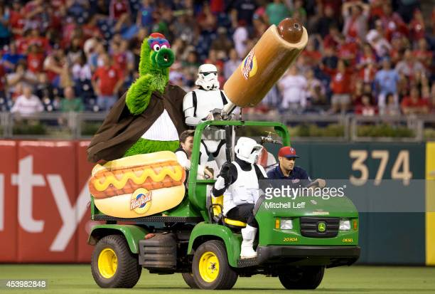 Stormtroopers help the Phillie Phanatic shoot hot dogs in the stands between innings of the game between the St Louis Cardinals and Philadelphia...