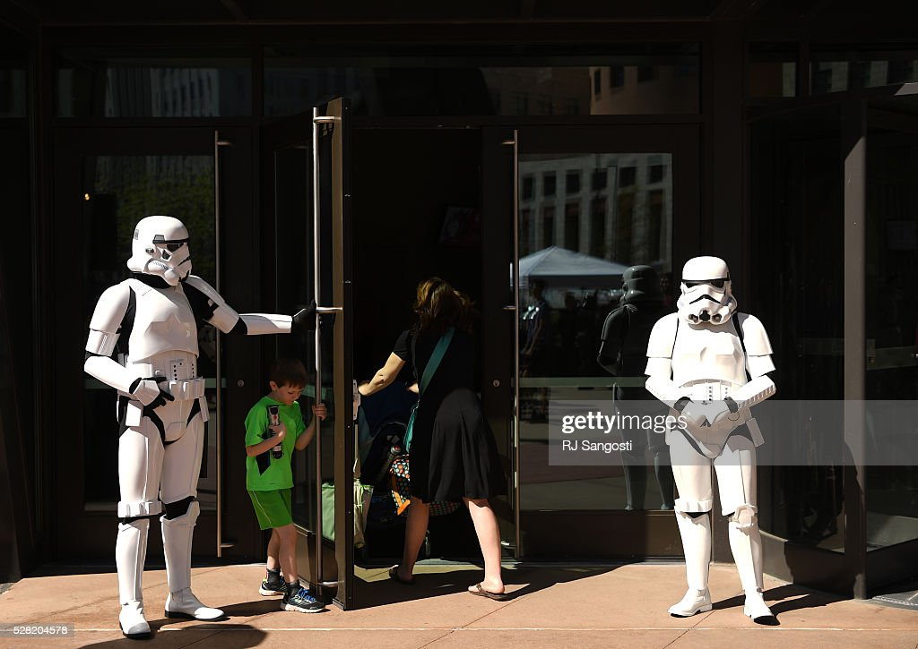 A Stormtroopers hold the doors for visitors at the Denver Art Museum during a May the 4th Be With You event to kick off ticket sales for the upcoming exhibition, Star Wars and the Power of Costume, opening at the DAM in November, May 04, 2016. Costumed characters entertained fans at the museum.