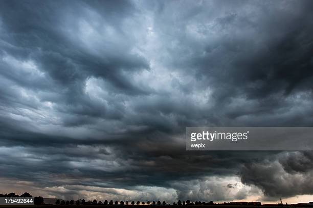 Stormy cloudy sky dramatic dangerous dark gray cloudscape