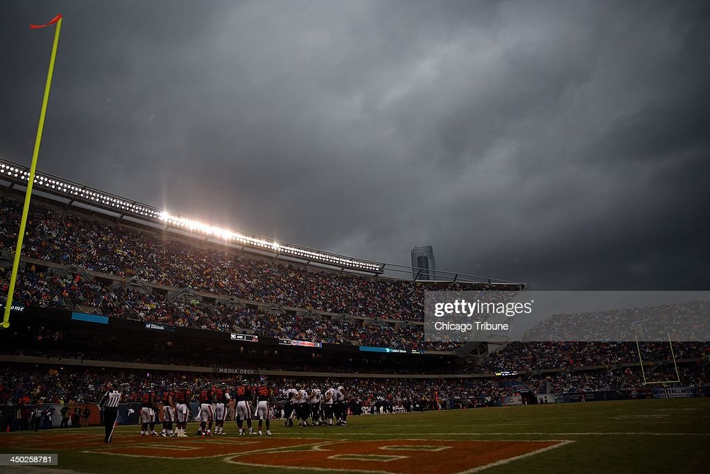 Stormy skies pass over Soldier Field during the first quarter of the Chicago Bears' game against the Baltimore Ravens in Chicago on Sunday, Nov. 17, 2013.