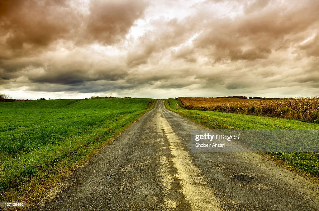 Stormy sky and rural road : Stock Photo