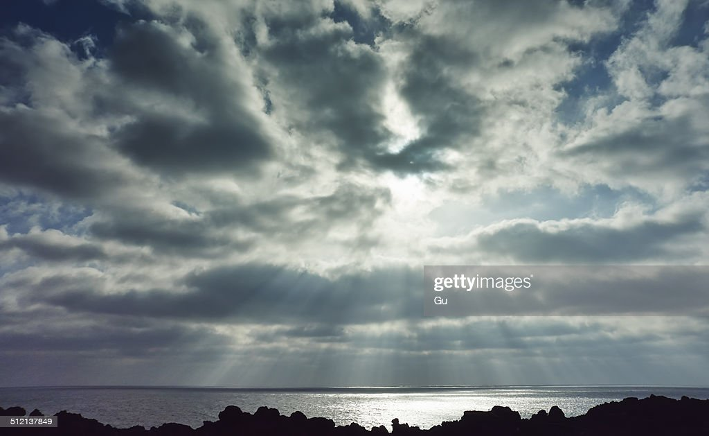 Stormy sky and silhouetted rocks, Lanzarote, Canary Islands, Spain