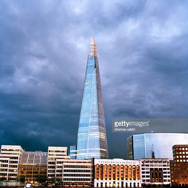Stormy sky over city skyline at dusk