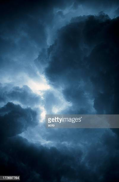 A stormy sky with dark clouds and a little bit of light