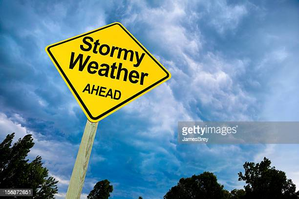 Stormy Weather Ahead Road Sign Against Ominous Dark Sky