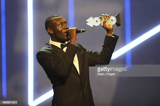Stormzy accepts his award for Best Grime Act during the MOBO Awards at First Direct Arena on November 4 2015 in Leeds England