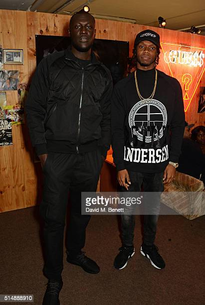 Stormzy and Krept attend the launch of 1st GUESS Originals X A$AP Rocky collection within Selfridges on March 11 2016 in London England