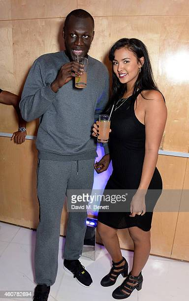 Stormzy and Maya Jama attend the Rinse FM 20th Birthday Anniversary Dinner at St Martins Lane Hotel on December 22 2014 in London England