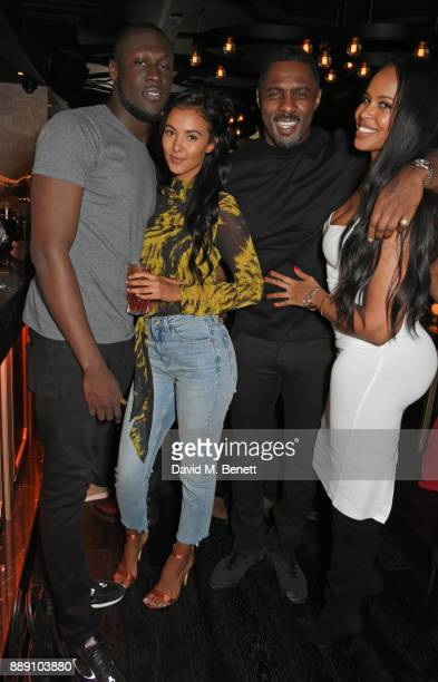 Stormzy Maya Jama Idris Elba and Sabrina Dhowre attend Idris Elba's Christmas Party at Kadie's Cocktail Bar Club on December 9 2017 in London England