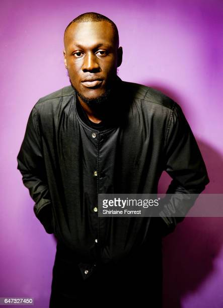 Stormzy poses backstage before meeting fans and signing copies of his new album 'Gang Signs And Prayer' at HMV Liverpool One on March 2 2017 in...