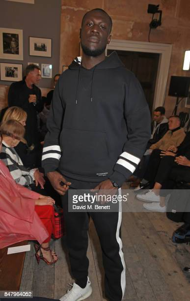 Stormzy wearing Burberry at the Burberry September 2017 at London Fashion Week at The Old Sessions House on September 16 2017 in London England
