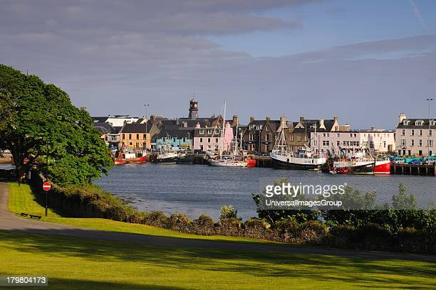 Stornoway Harbour showing houses on water Isle of Lewis Outer Hebrides Scotland United Kingdom