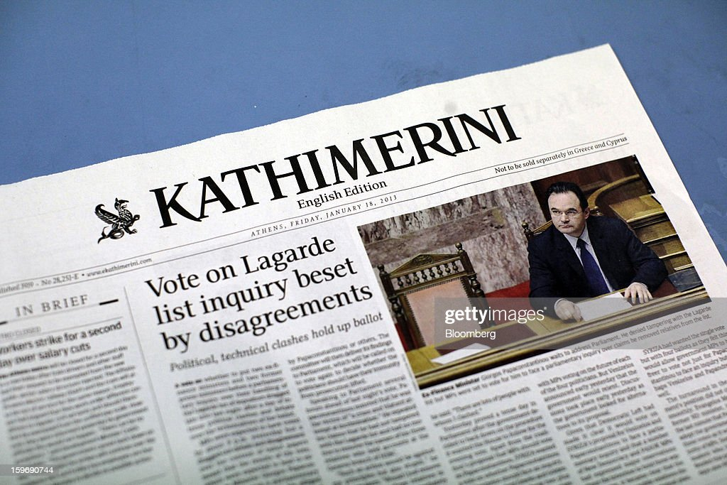 A story about George Papaconstantinou, Greece's former finance minister, is seen on a page of Kathimerini newspaper's English language edition at the Kathimerini printing plant in Paiania, Greece, on Thursday, Jan. 17, 2013. An anarchist group claimed responsibility for a series of attacks early on Jan. 11 when unidentified perpetrators threw makeshift bombs made from propane gas canisters into the homes of five Greek journalists working for national media saying it was to protest coverage of the country's financial crisis seen as sympathetic to the government. Photographer: Kostas Tsironis/Bloomberg via Getty Images