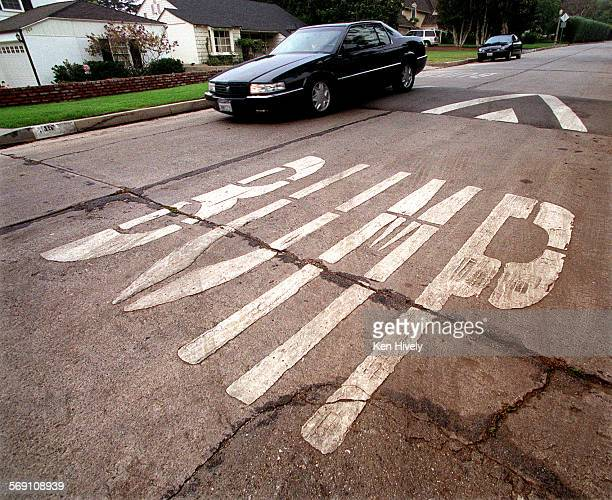 Story about people concerned about traffic in their area can get speed bumps traffic signs installed in their neighborhood Photo of speed bump in 100...