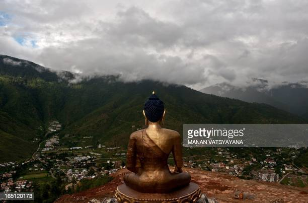 TOURISM story by Adam Plowright In this photograph taken on August 19 the giant Buddha Dordenma statue still underconstruction overlooks the capital...