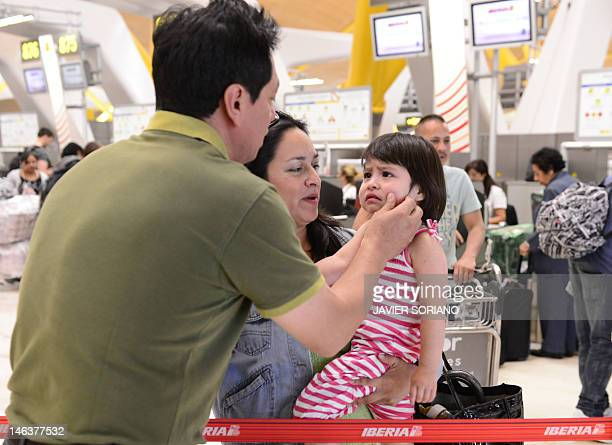 Latin American immigrants leave crisithit Spain in droves BY Ecuadorian Patricia Herrera and her daughter Desiree say goodbye to a friend at Madrid...