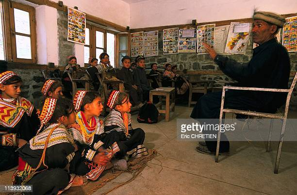 Storyteller Of The Tradition Involved In A Kalash School In Pakistan In 2001Mallik tradition storyteller acting in Kalash schools Kalash school of...