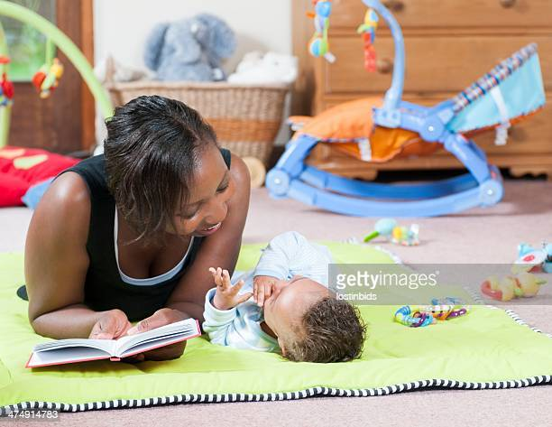 Storytime on the Playmat With Carer And Baby