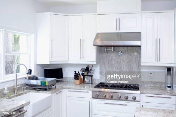 Stove, cabinets and sink in modern kitchen
