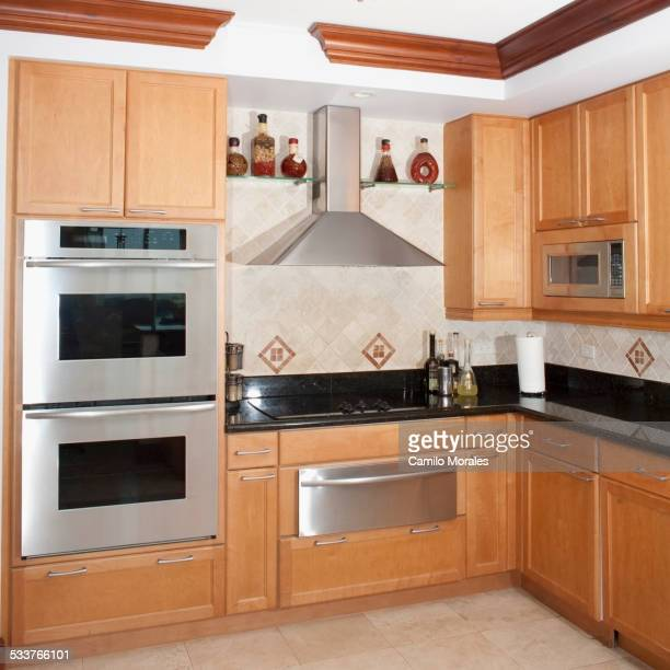 Stove, oven and cabinets in kitchen