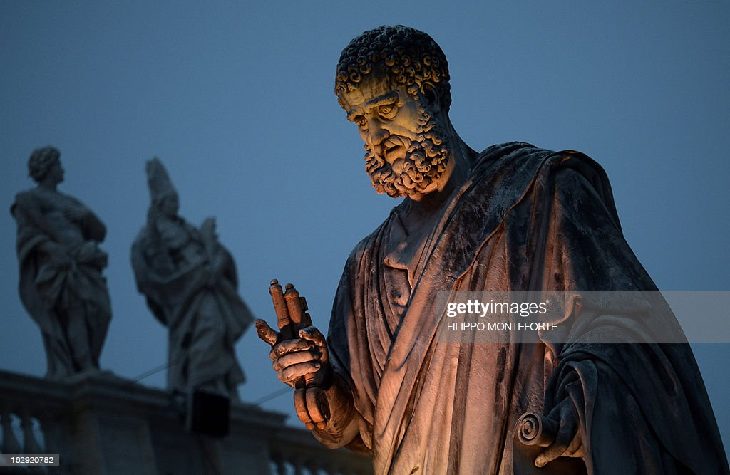 St.Peter Statue is pictured on the St.Peter's Square at the Vatican on March 01, 2013. Pope Benedict XVI has become the day before the first pope to resign in over 700 years, telling a tearful crowd of faithful that he will now be 'a simple pilgrim' as cardinals on Friday begin preparing for a conclave in the Sistine Chapel to elect his successor. AFP PHOTO / FILIPPO MONTEFORTE