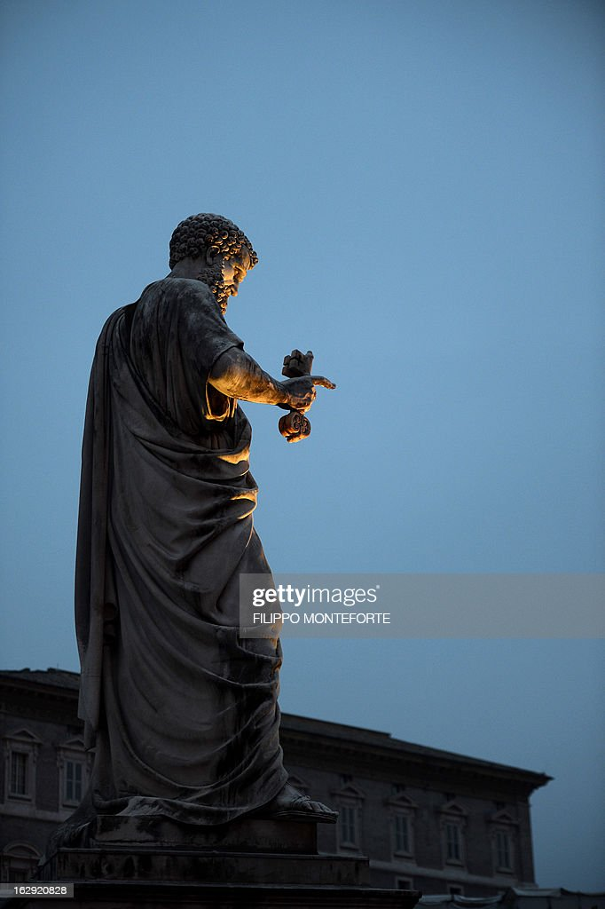 St.Peter Statue is pictured on the St.Peter's Square at the Vatican on March 01, 2013. Pope Benedict XVI has become the day before the first pope to resign in over 700 years, telling a tearful crowd of faithful that he will now be 'a simple pilgrim' as cardinals on Friday begin preparing for a conclave in the Sistine Chapel to elect his successor.