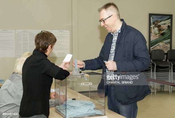 Stéphane Claireaux assistant to French minister of Overseas Terrotories Annick Girardin casts his ballot in the French legislative elections at a...