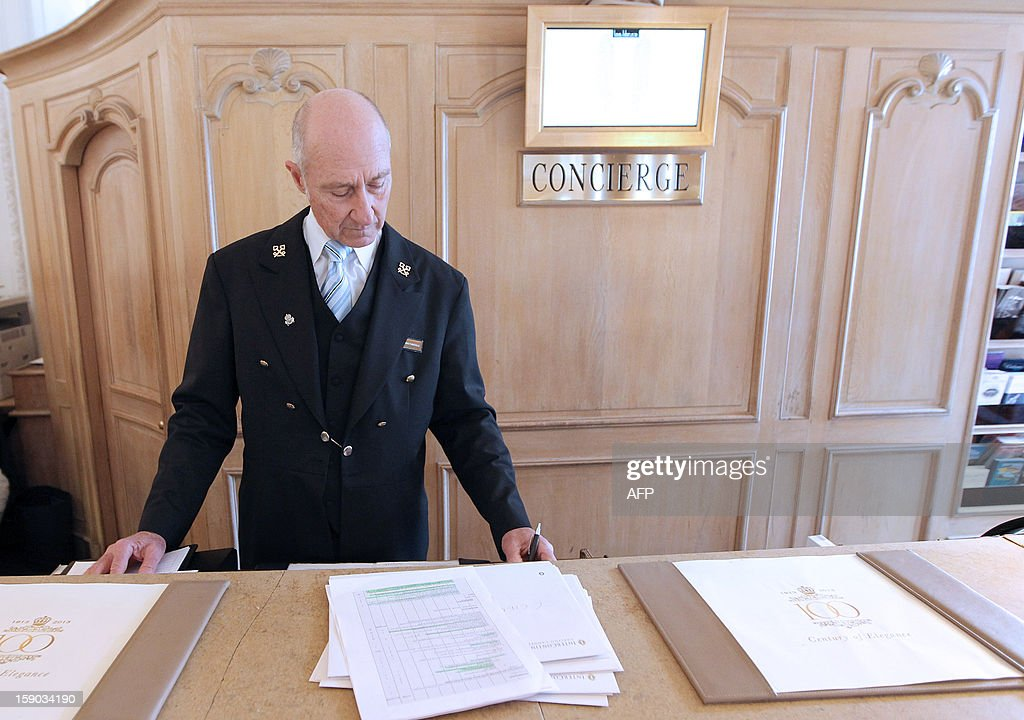 Stéphane Fanciulli, chief concierge of the Intercontinental Carlton Hotel works at the reception desk of the hotel on January 4, 2013 in Cannes, southeastern France. AFP PHOTO / JEAN CHRISTOPHE MAGNENET