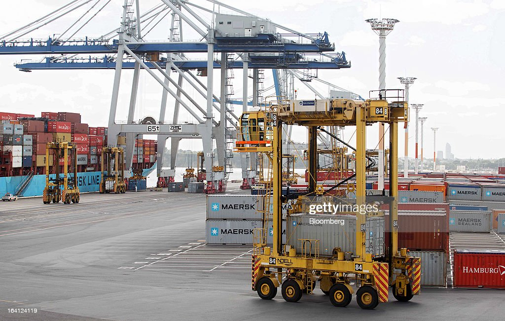 A straddle carrier manufactured by Terex Corp.'s Noell Mobile Systems GmbH unit transports a Maersk Line shipping container at a Ports of Auckland terminal in Auckland, New Zealand, on Tuesday, March 19, 2013. The New Zealand dollar, nicknamed the kiwi, fell against most major peers as the government said the country's most widespread drought in at least 30 years reduces pressure to raise interest rates. Photographer: Brendon O'Hagan/Bloomberg via Getty Images