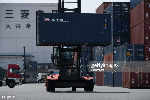 A straddle carrier moves a container at a shipping terminal in Tokyo Japan on Monday July 10 2017 Nippon Yusen KK Mitsui OSK Lines Ltd and Kawasaki...