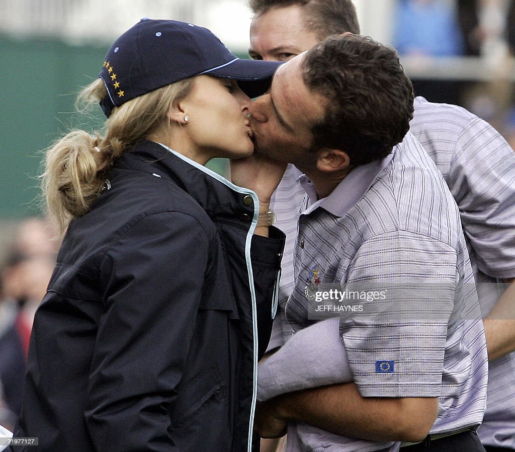 European Ryder Cup player Sergio Garcia (R) kisses his partner Morgan Norman after Garcia and Donald beat Phil Mickelson and David Toms of the United States, during the afternoon foursomes session of the second day of the 2006 Ryder Cup at the K Club in Straffan, Co Kildare, in the Republic of Ireland, 23 September 2006.