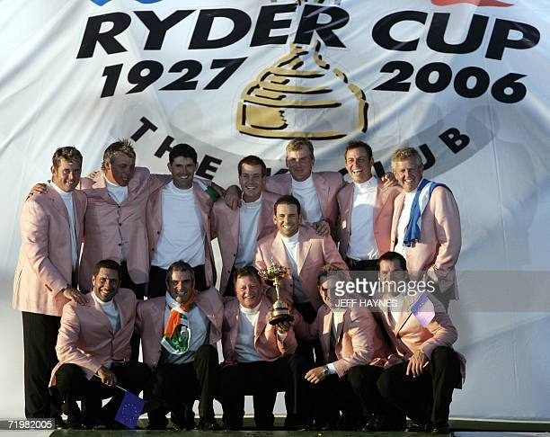 European Ryder Cup team led by Captain Ian Woosnam hold the Ryder Cup trophy after Europe retained the Ryder Cup over the United States on the third...