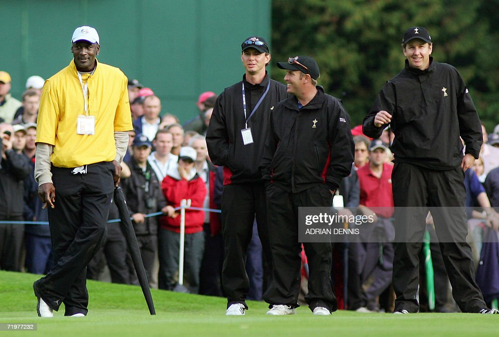 Former NBA legend <a gi-track='captionPersonalityLinkClicked' href=/galleries/search?phrase=Michael+Jordan+-+Basketball+Player&family=editorial&specificpeople=73625 ng-click='$event.stopPropagation()'>Michael Jordan</a> (L) watches the action with United States Ryder Cup player J.J. Henry (R) and other squad members in the afternoon foursomes session of the second day of the 2006 Ryder Cup at the K Club in Straffan, Co Kildare, in the Republic of Ireland, 23 September 2006.