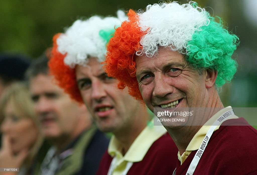 Golf fans wearing wigs decorated in the Irish flag colours watch the action in the afternoon foursomes session of the second day of the 2006 Ryder Cup between Europe and the United States at the K Club in Straffan, Co Kildare, in the Republic of Ireland, 23 September 2006.