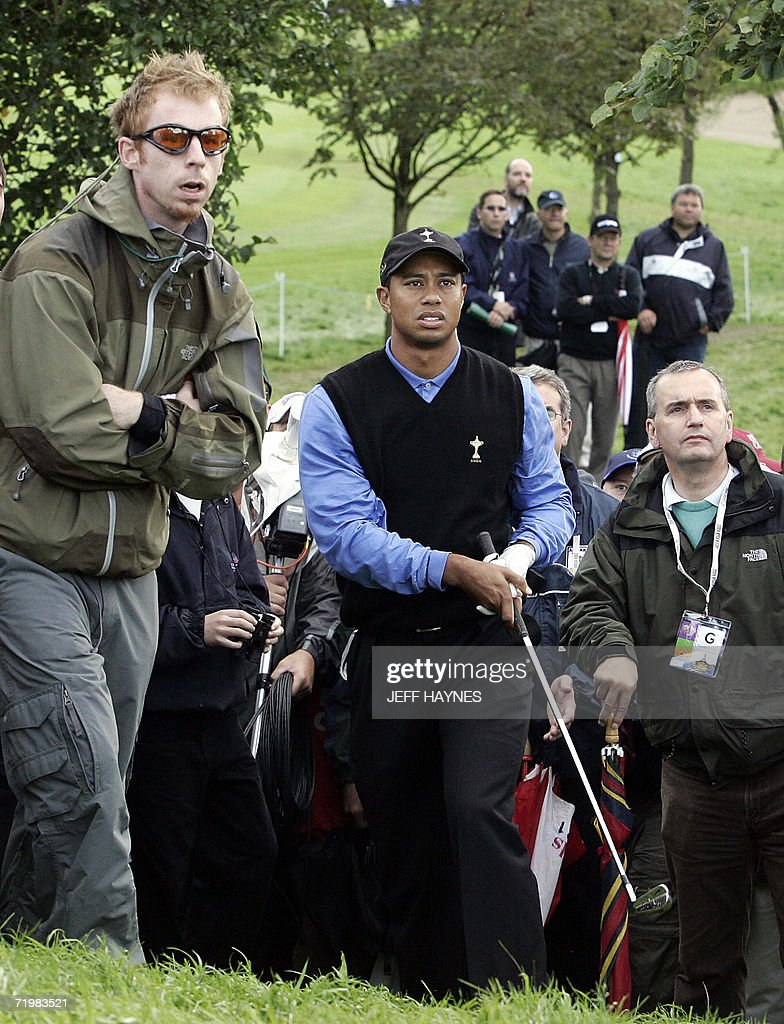 United States Ryder Cup player <a gi-track='captionPersonalityLinkClicked' href=/galleries/search?phrase=Tiger+Woods&family=editorial&specificpeople=157537 ng-click='$event.stopPropagation()'>Tiger Woods</a> (C) hits out from the rough on the 5th hole, as he and partner Jim Furyk fall behind the European team of Lee Westwood and Darren Clarke, during the morning fourballs session of the second day of the 2006 Ryder Cup at the K Club in Straffan, Co Kildare, in the Republic of Ireland, 23 September 2006