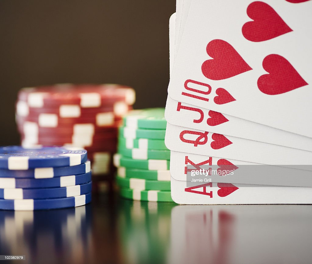 Straight flush in front of poker chips, close-up : Stock Photo
