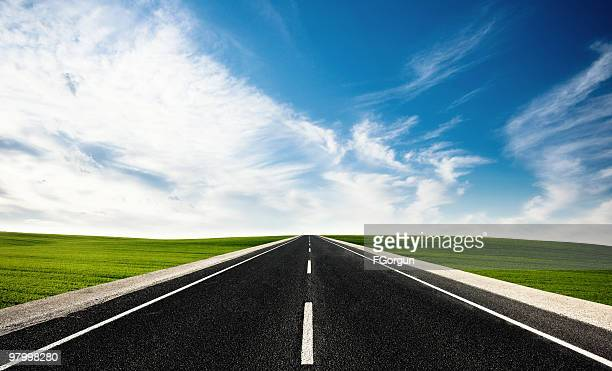 Straight highway with grass on each side