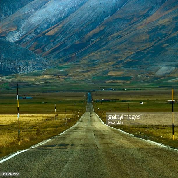 Straight path against mountain