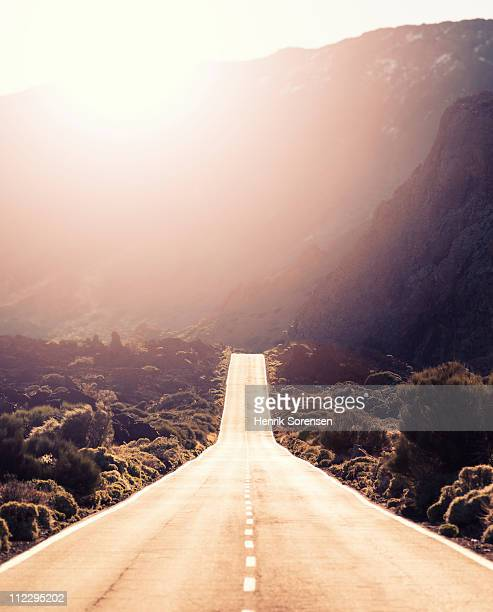 Straight road leading into mountainous landscape