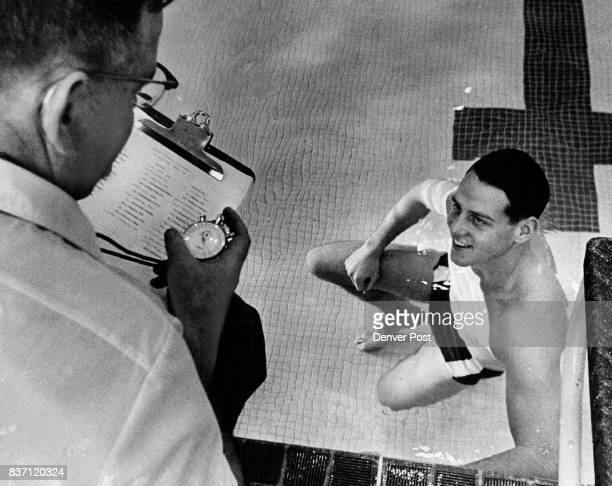 Strain John COACH LOU PARKER CHECKS THE TIME ON HIS VERSATILE SWIMMERJOHN STRAIN Ten years of practice is one of secrets of Strain's swimming success...