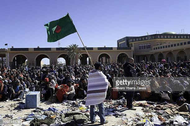 Stranded foreign workers who have fled Libya wait at the border to enter a refugee camp on March 2 2011 in Ras Jdir close to the border between...