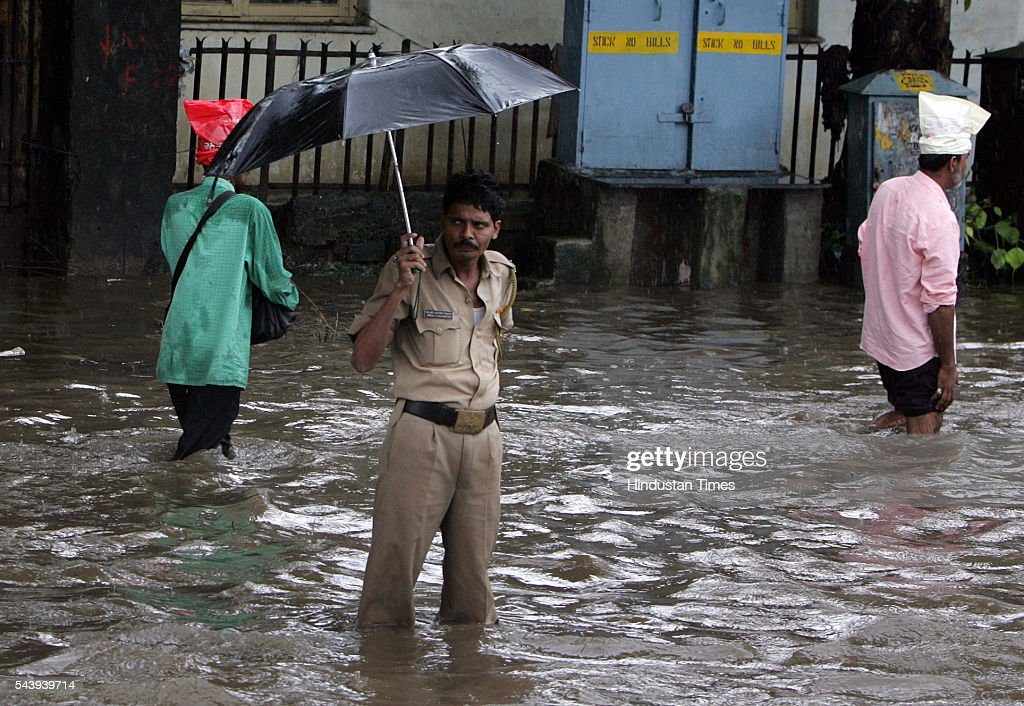 Stranded in the middle of a flooded street near Hindmata Cinema at Parel, a bewildered policeman tries to find an exit from the puddle that he is in on July 21, 2005 in Mumbai, India. Heavy rains lashed across the city leaving most of the areas around the city in a flooded state.