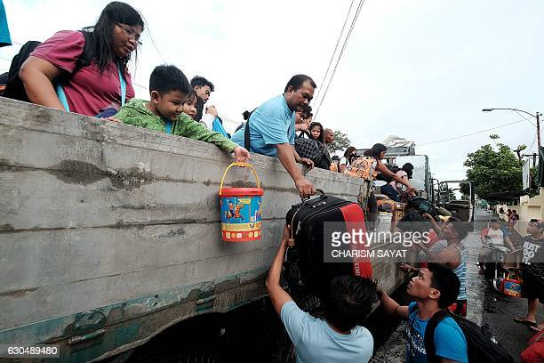 Stranded passengers from Tabaco port are evacuated by the local government in Tabaco City Albay province on December 24 2016 after their seafaring...